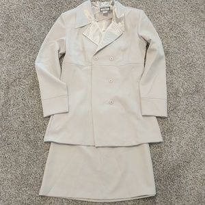 Three piece skirt suit